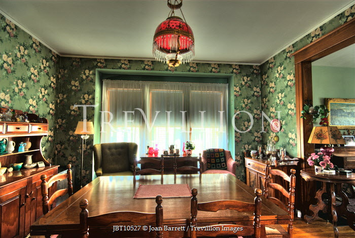 Joan Barrett LAMP OVER TABLE AND CHAIRS IN RETRO ROOM Interiors/Rooms
