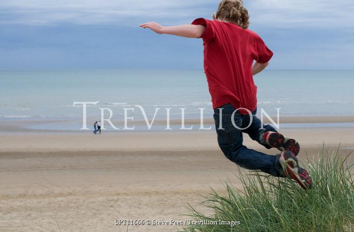 Steve Peet BOY JUMPING OVER BEACH SAND DUNE Women