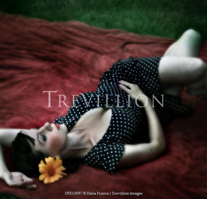 Dana France WOMAN LYING DOWN IN POLKA DOT DRESS Women
