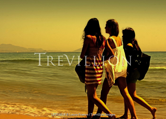 Laura Franco THREE WOMEN WALKING ON BEACH Groups/Crowds