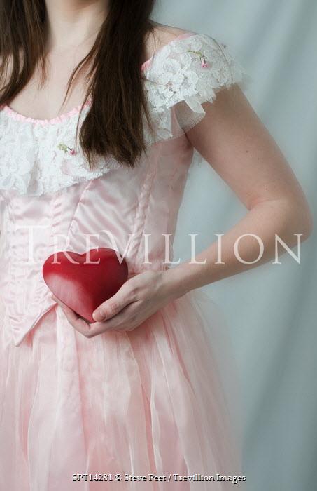 Steve Peet WOMAN HOLDING RED HEART Women