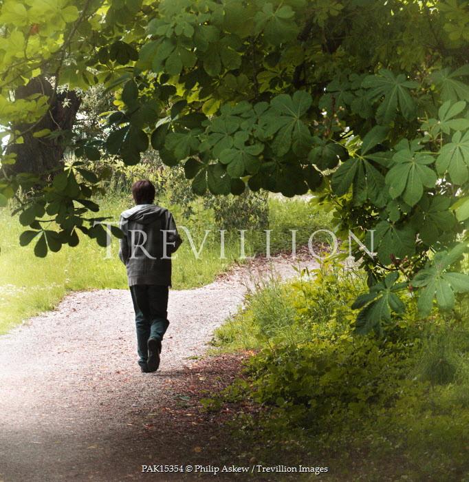 Philip Askew BOY WALKING ON RURAL PATHWAY Children