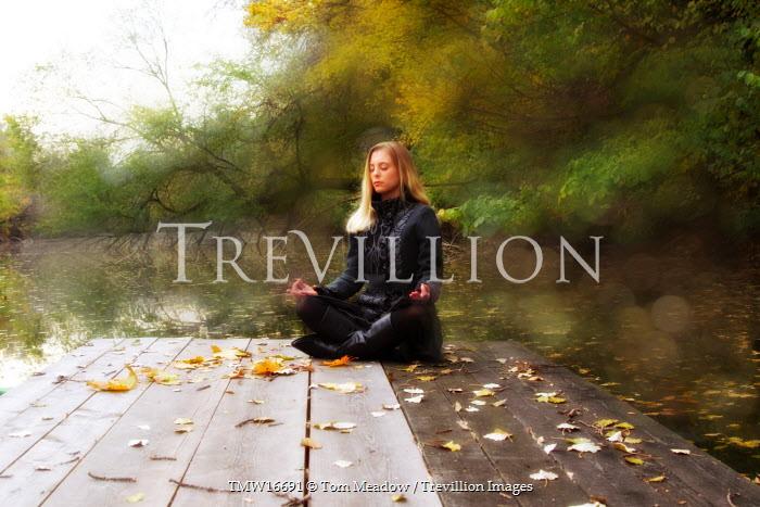 Tom Meadow blonde woman meditating by lake Women