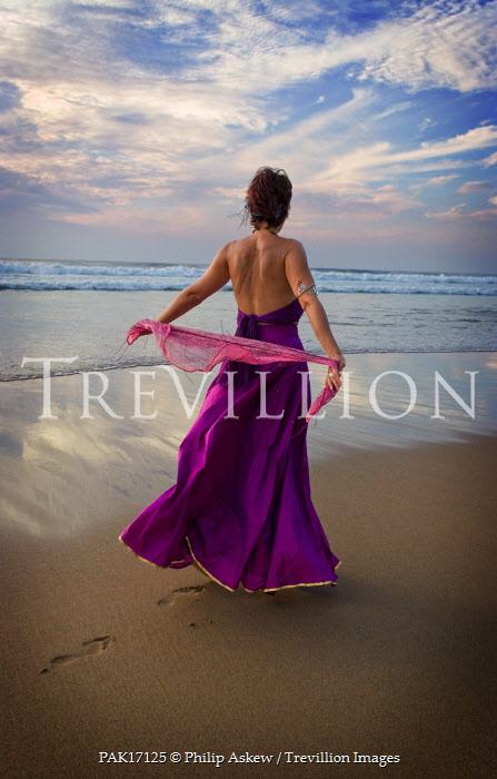 Philip Askew WOMAN IN PURPLE DRESS ON BEACH Women