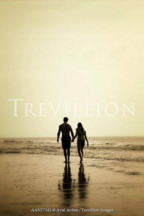 Ayal Ardon COUPLE WALK ALONG BEACH Couples