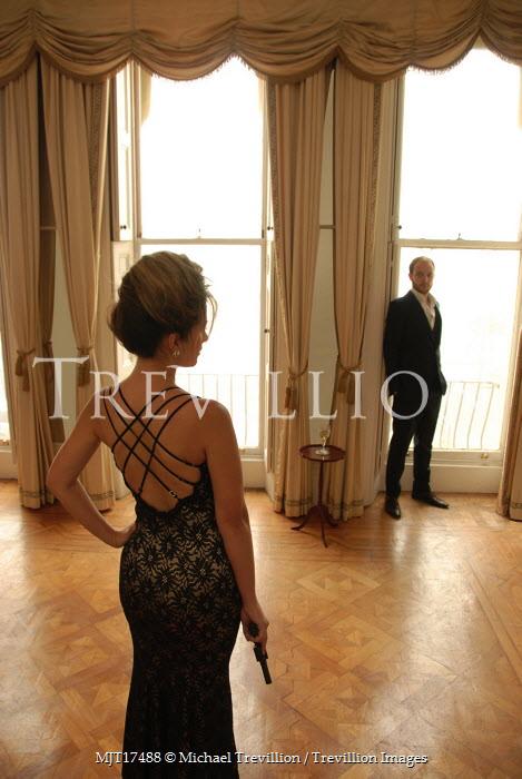 Michael Trevillion COUPLE STANDING INTERIOR WINDOW GUN Couples