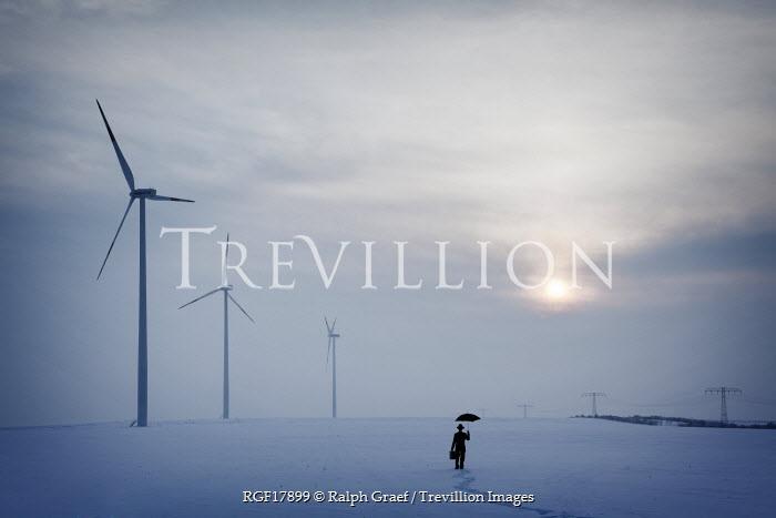 Ralph Graef WOMAN STANDING SNOW WIND TURBINES Women