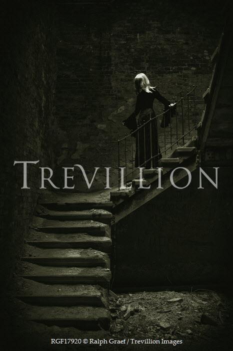 Ralph Graef blonde woman on dark staircase Women