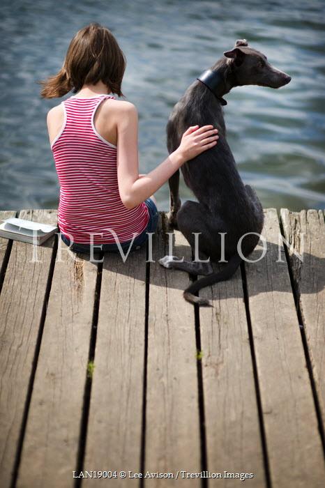 Lee Avison GIRL AND DOG ON JETTY Children