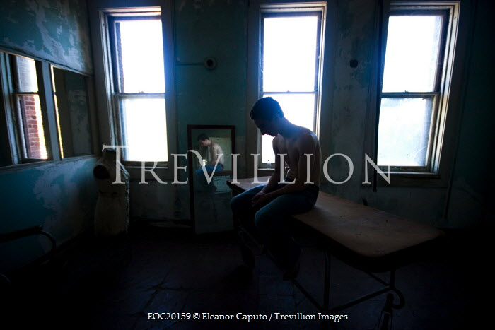 Eleanor Caputo man sitting on table in flat Men