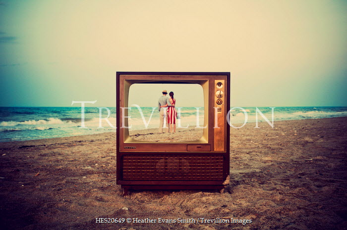 Heather Evans Smith COUPLE STANDING ON BEACH WITH TELEVISION Couples