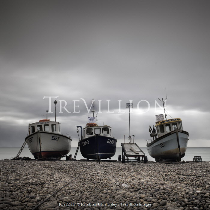 Jonathan Chritchley THREE BOATS MOORED ON PEBBLE BEACH Boats
