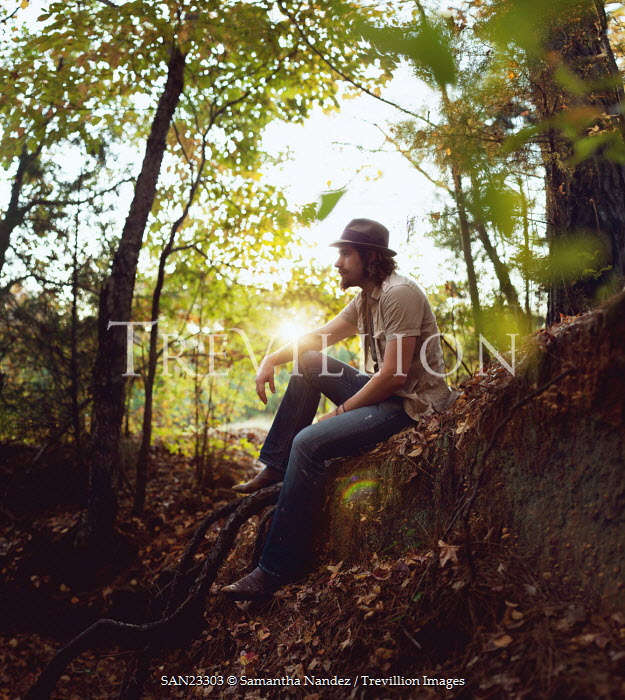Samantha Nandez Man sat in countryside Men