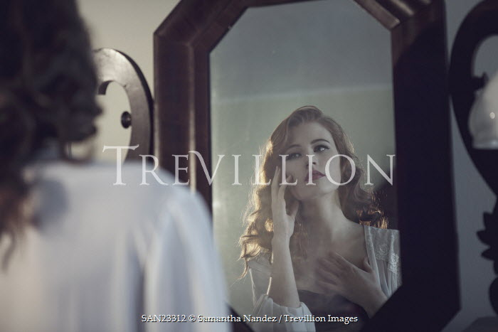 Samantha Nandez Woman looking in mirror Women