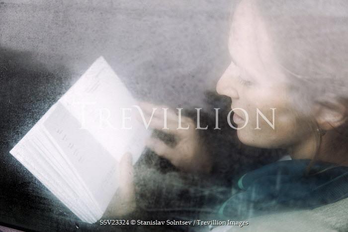 Stanislav Solntsev WOMAN READING BEHIND WINDOW Women