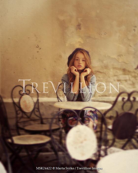 Marta Syrko TEENAGER SITTING IN CAFE Children