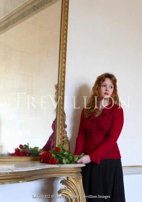 Lesley Aggar WOMAN WITH RED HAIR STANDING BY MIRROR Women