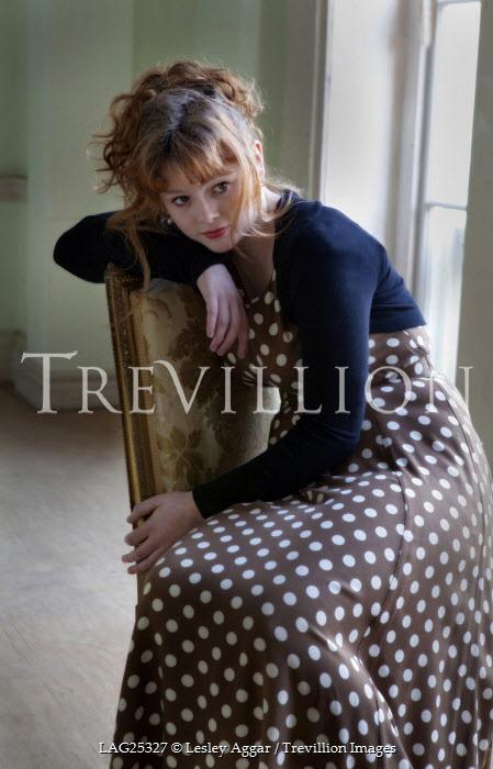 Lesley Aggar WOMAN SITTING IN SPOTTY DRESS Women