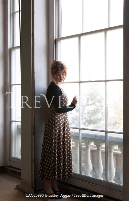 Lesley Aggar WOMAN IN SPOTTY DRESS AT WINDOW Women