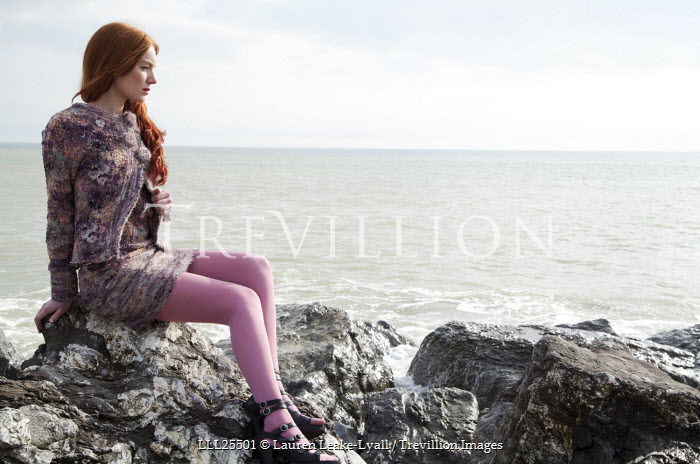 Lauren Leake-Lyall WOMAN WITH RED HAIR SITTING BY SEA Women