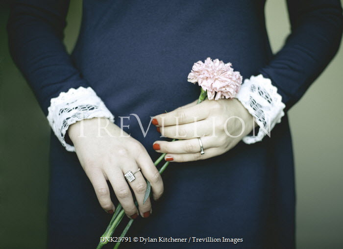 Dylan Kitchener FEMALE HANDS HOLDING PINK FLOWER Body Detail