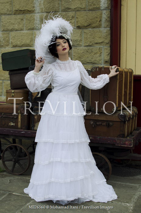Mohamad Itani EDWARDIAN WOMAN IN WHITE WITH SUITCASES Women