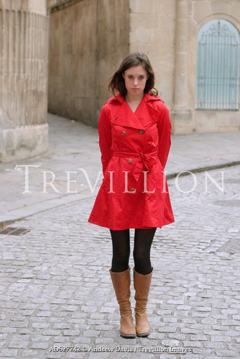 Andrew Davis GIRL IN RED MAC IN COBBLED STREET Women