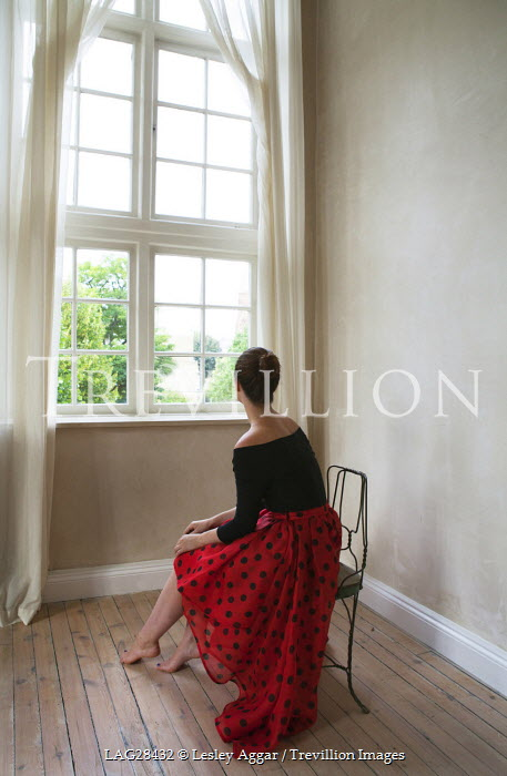 Lesley Aggar WOMAN IN RED SITTING INDOORS Women