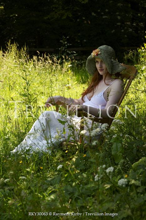Rayment Kirby WOMAN SITTING IN SUNLIT FIELD Women