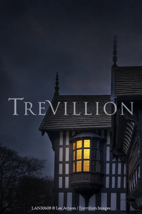 Lee Avison LIGHT SHINING IN TUDOR WINDOW AT NIGHT Houses