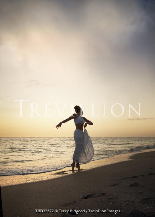 Terry Bidgood WOMAN DANCING ON SUMMERY BEACH Women