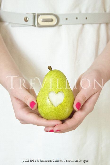 Julianna Collett WOMAN HOLDING PEAR WITH HEART Women