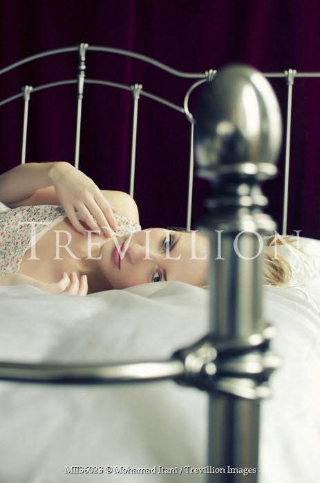 Mohamad Itani WOMAN LYING ON DOUBLE BED Women