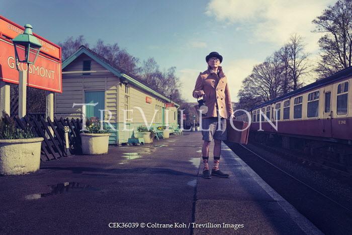 Coltrane Koh MAN STANDING AT RAILWAY STATION Men