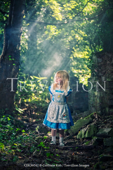 Coltrane Koh CHILD IN BLUE DRESS IN FOREST Children