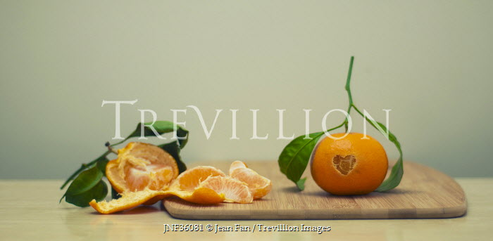 Jean Fan ORANGE SATSUMA FRUIT ON CHOPPING BOARD Miscellaneous Objects