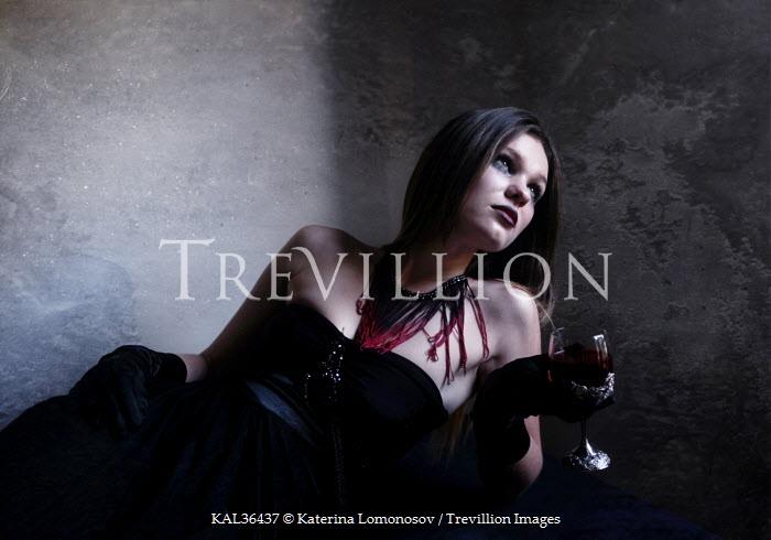 Katerina Lomonosov WOMAN LYING DRINKING RED WINE Women