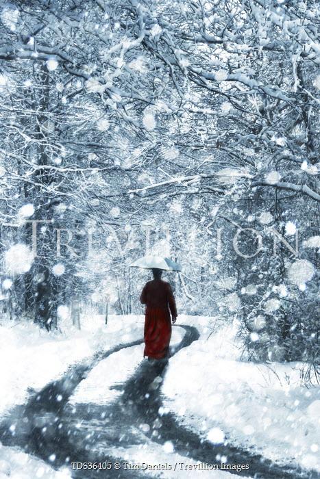 Tim Daniels WOMAN WALKING ON SNOWY ROAD Women