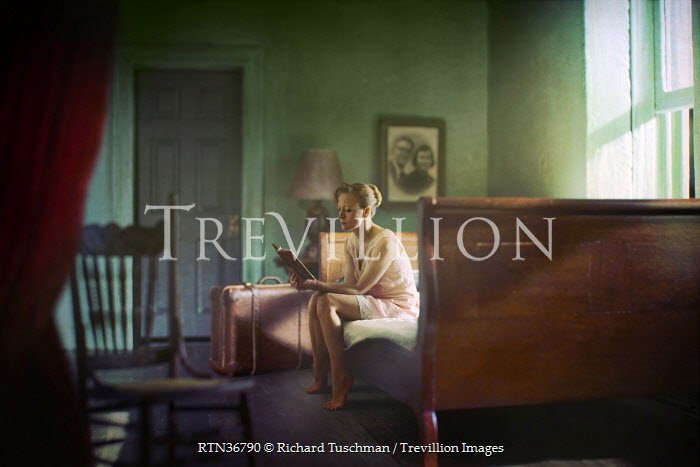 Richard Tuschman WOMAN SITTING READING BOOK Women