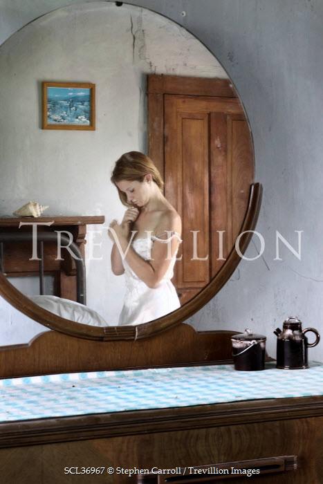 Stephen Carroll WOMAN REFLECTED IN BEDROOM MIRROR Women