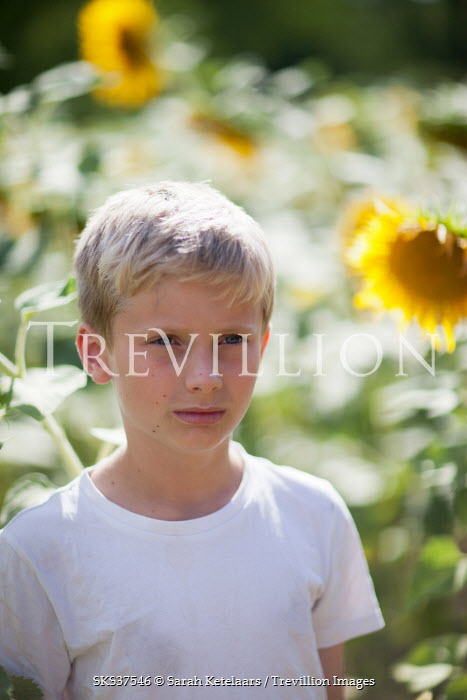 Sarah Ketelaars BOY IN FIELD WITH SUNFLOWERS Children