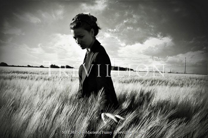 Mariesol Fumy WOMAN IN FIELD TOUCHING GRASS Women