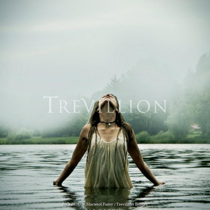 Mariesol Fumy WOMAN STANDING IN FOGGY LAKE Women