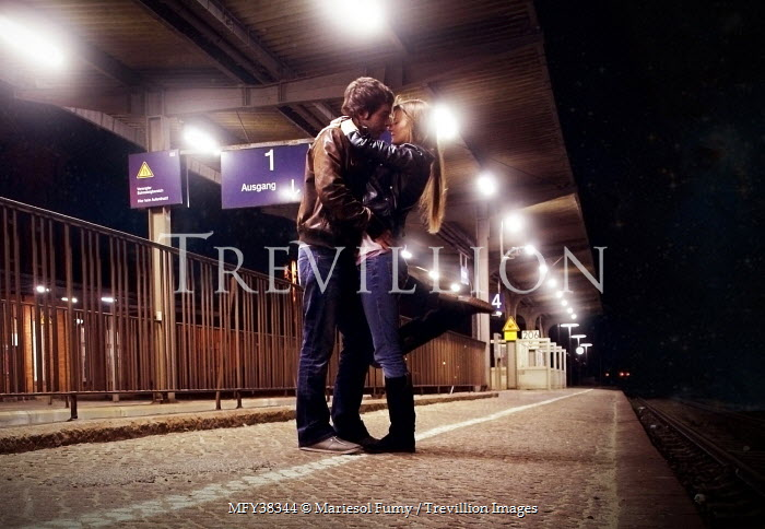Mariesol Fumy COUPLE EMBRACING ON STATION PLATFORM Couples