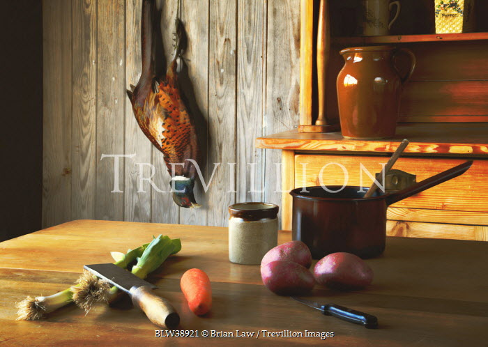 Brian Law KITCHEN TABLE WITH COOKING INGREDIENTS AND PHEASANT Miscellaneous Objects