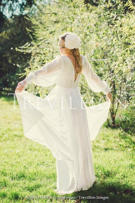 Claire Morgan WOMAN IN WHITE DRESS IN GARDEN Women