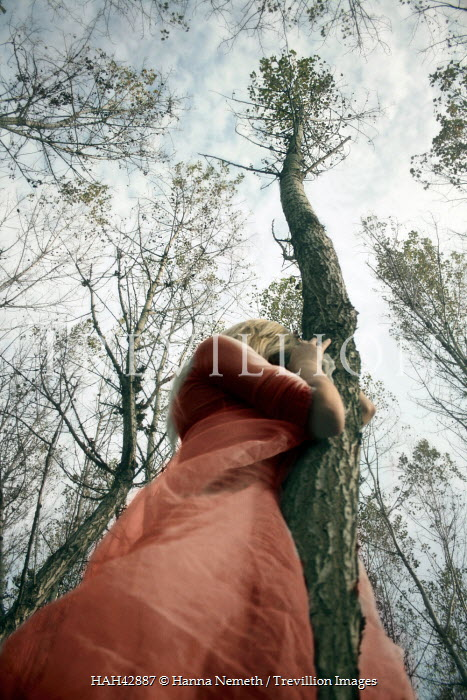 Hanna Nemeth WOMAN HOLDING TALL TREE Women