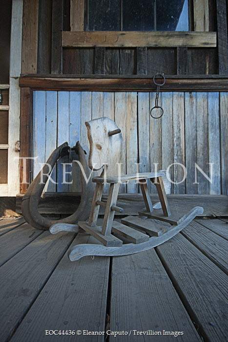 Eleanor Caputo SMALL WOODEN ROCKING HORSE ON PORCH Miscellaneous Objects
