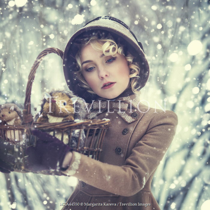 Margarita Kareva WOMAN IN SNOW WITH TOY IN BASKET Women