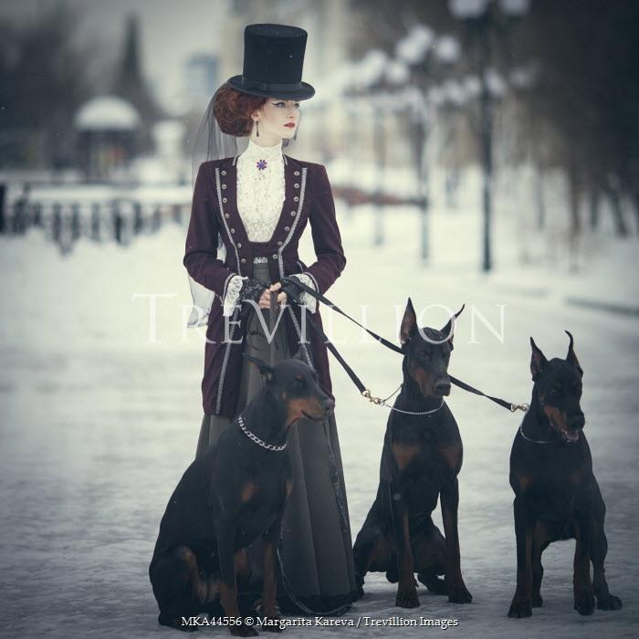 Margarita Kareva VINTAGE WOMAN IN SNOW WITH DOGS Women